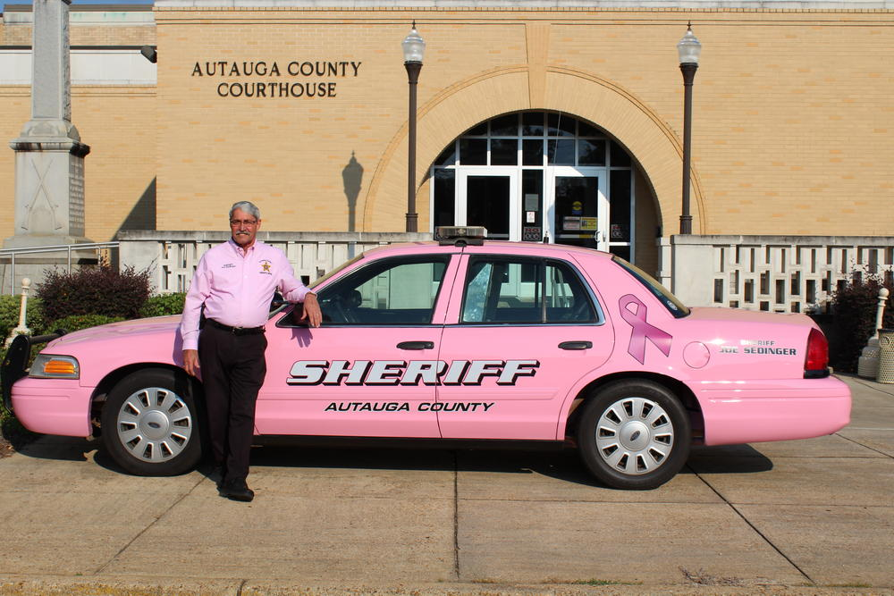 Sheriff Sedinger with the pink patrol car