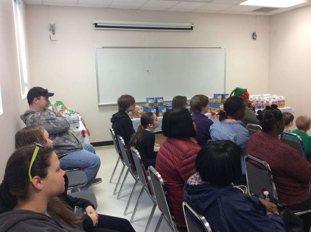 Families gathered to receive Christmas meal