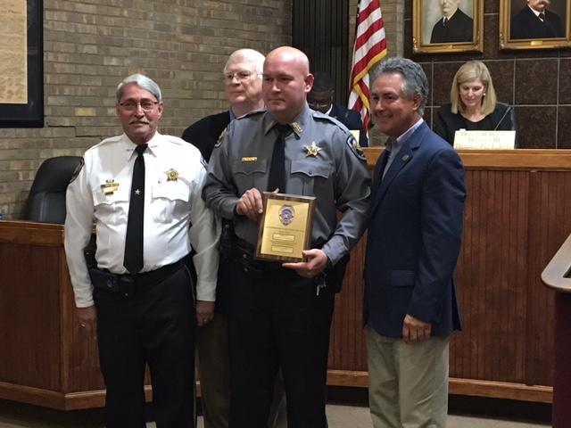 Animal Control/Deputy Josh Averette receiving award during Prattville City Council meeting